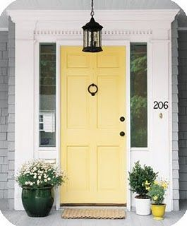 yellow front door heralds spring and summer