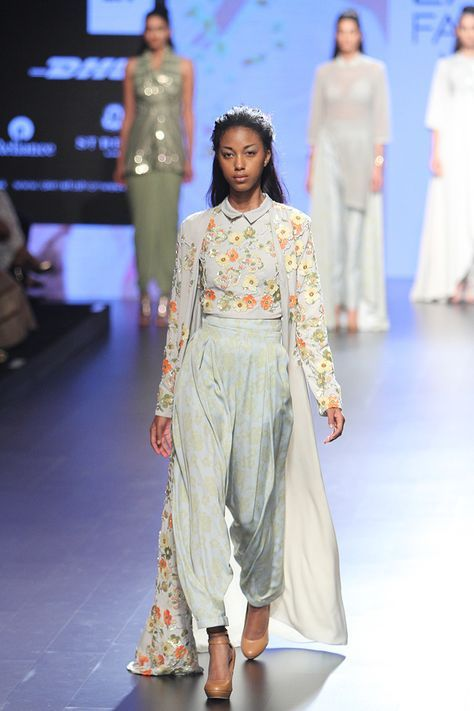 NEETA LULLA Grey floral embroidered crop top and sequins work cape with printed salwaar pants. To Customised this garment log on to www.in at its reasonable rate