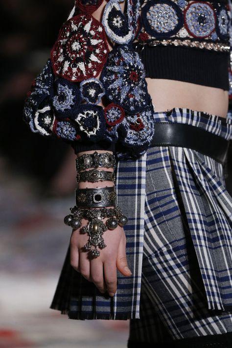 Alexander McQueen Celtic check kilt worn with a crocheted Fairisle jumper and hand jewellery. By Niki Kaliakatsou