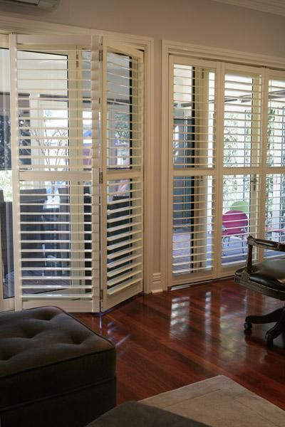 floor to ceiling shutters with triangular top home decorating