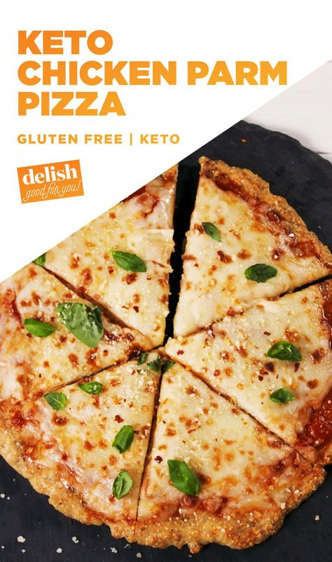 Cheesy Chicken Parm Pizza WITHOUT the carbs?! Sign us up. Get the recipe at Delish.com. #cheese #chicken #parm #parmesan #pizza #keto #diet #healthy #ketogenic #glutenfree #gluten #delish #recipe #easyrecipe #NoEggKetoBreakfast