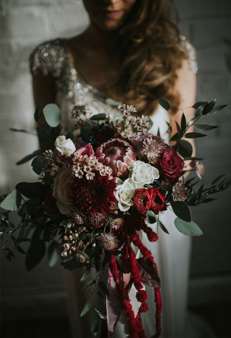 deep red roses pink proteas gand greenery eucalyptus wedding bouquet ideas for winter #weddings #weddingbouquets #weddingideas #bohemian #boho #greenery #weddingflowers #weddinginspiration