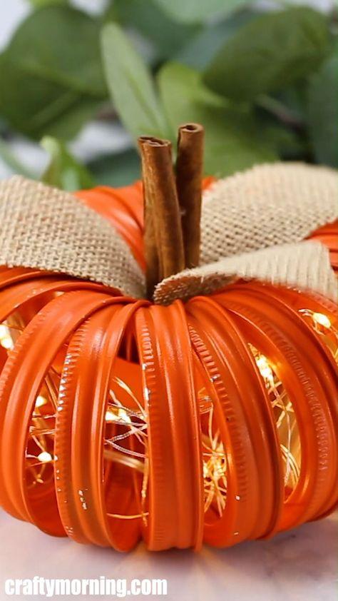 Mason Jar Lid Lighted Pumpkin- adorable fall DIY project craft to make. Halloween home decoration for inside. Lights inside so it looks cool at night. Fun pumpkin decor.