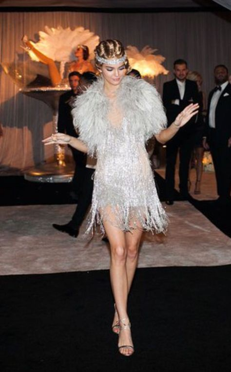 graduation clothes This shimmery, silver, and exotic dress simply screams the fashion from the Great Gatsby. The added touch of the fur with a matching jeweled headband ties the whole outfit into place for the Ariana Andino