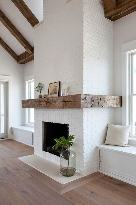 A mantle made from antique hand-hewn beams serves as the focal point of a New Jersey shorehouse. Home Fireplace, Fireplace Design, Farmhouse Fireplace, Fireplace In Kitchen, Brick Fireplace Makeover, Fireplace With Wood Mantle, Rustic Farmhouse, Brick Fireplace Remodel, Reclaimed Wood Mantle
