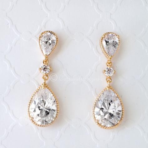 These pear cut dangle earrings shine with beautiful cubic zirconia stones. Could be worn for any special occasion. Post back, 1.25 inches long and 1/2 of an inc