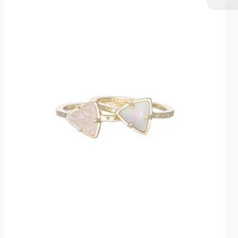 Kendra Scott Ann Stackable Rings - Iridescent Viva Authentic Kendra Scott Ann Stackable Rings in Iridescent Viva. 2 rings with gold-plated bands, one with a white iridescent stone and the other with iridescent drusy stone. Wear stacked or separate. So sad to be selling these :( Gently loved with slight fading on the edges as shown in the 3rd picture. These are out of stock on Kendra Scott, so you won't be able to find them in many other places!! Accepting $40 or best offer :) Includes Kendra…