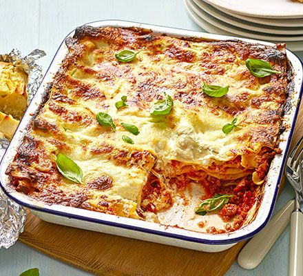 Kids will love to help assemble this easiest-ever pasta bake with streaky bacon, beef mince, a crème fraîche sauce and gooey mozzarella