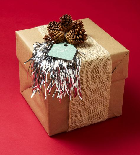 Create a pretty gift wrap with kraft paper, burlap, tinsel and pine cones: http://www.midwestliving.com/holidays/christmas/easy-christmas-gift-wrap-ideas/?page=20