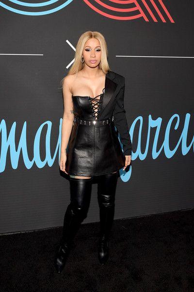 Cardi B in a black leather dress
