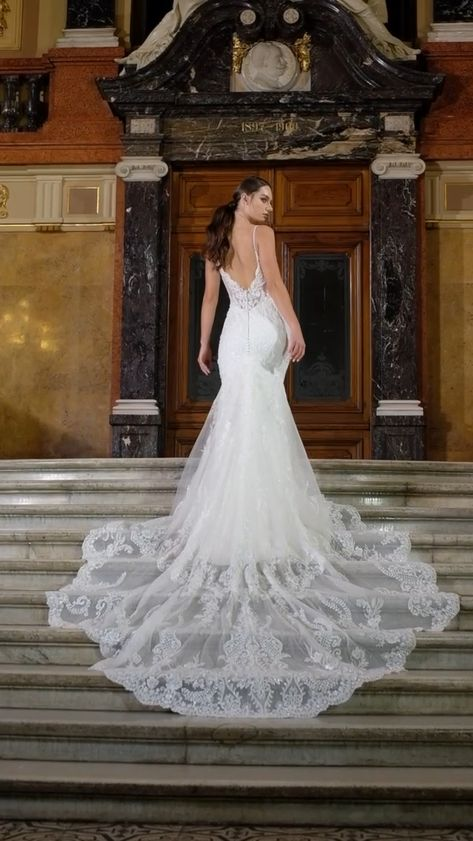 A regal crepe gown meants for the most exquiste bride to be. Decorated along the skirt are embroidered beaded lace appliques and glass beads with sequns that make this gown sparkle all around. Thin beaded straps lead down the reveal a deep illusion v-neckline that is sexy and one of a kind. The front fitted bodice features a deep v-neck that reveals all the most sensational neckline, leaving you to look flawless as ever. #weddingdress #weddinggown #mermaidweddingdress #laceweddingdress #bride