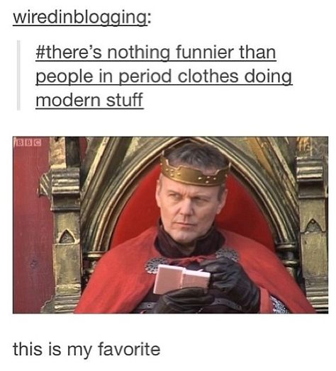 Uther Pendragon is in the middle of a MarioKart race, you shall not interrupt him! On a pink Nintendo!