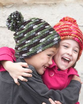 With its spiral crocheted construction and adorable pompom topper, this hat is a cute and cozy cold-weather accessory. Shown in Bernat Softee Chunky.