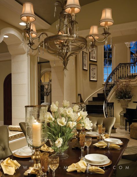 Anchor Builders   Marc-Michaels Interior Design, Inc.. The dining room in this luxury home is reached through columns & archways. The palette is neutral, cream & brown. Which coordinates with the staircase, also found here. Beautiful. .....V