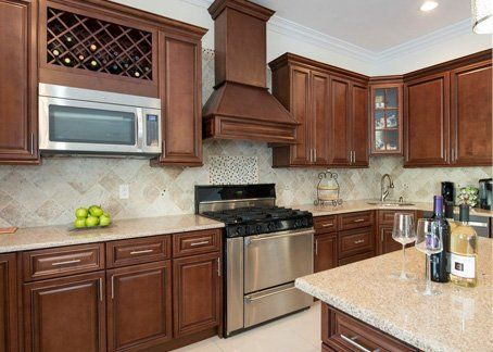 Wood Cabinets Are Available In An Array Of Door Styles Finishes And Materials That Brown Kitchen Cabinets Assembled Kitchen Cabinets Interior Design Kitchen