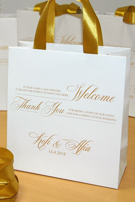 Gold Wedding welcome bags with satin ribbon handles and names, Elegant Personalized wedding gifts & favors for guests. #goldwedding #goldrings #weddingrings #personalized #bags #weddinggift #weddings #weddingbags #mrandmrs #weddingwelcomebags #welcomebags #bagsforguests #weddingwelcome #wedding #destinationwedding #weddingfavor #giftbags #partyfavor #weddingfavor #weddingfavors #weddingfavour #weddingfavours #personalizedgift #thankyou #weddingthankyou
