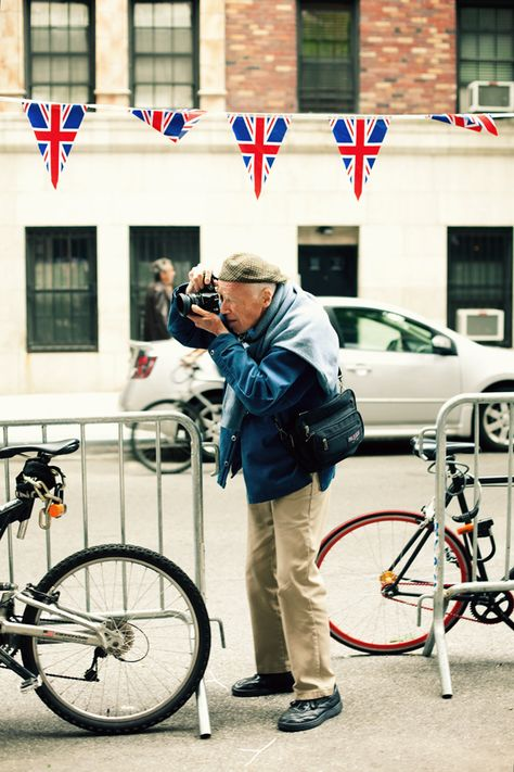 the notorious bill cunningham, photographing the street scenes of october's tweed run in new york city.