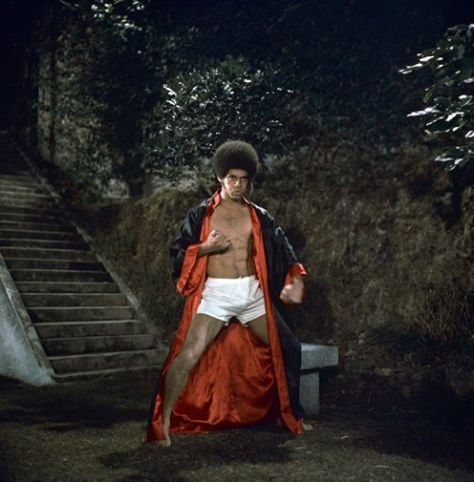"""Publicity photo of Jim Kelly for the 1973 martial arts film """"Enter the Dragon."""" Mr. Kelly, who died on June 29, 2013 at the age of 67, was a star of nine martial arts films in the """"blaxploitation"""" genre. He was a martial arts champion in real life."""