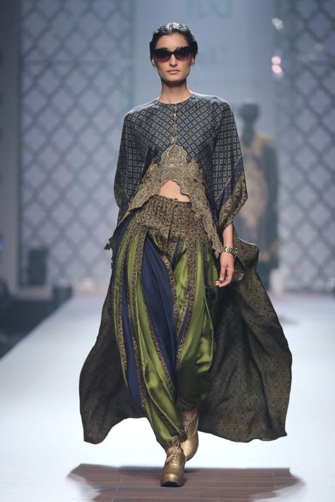 Printed rectangle navy blue cape with patial patti Color:Navy blue and green Fabric:TWILL SILK - TOP AND BOTTOM Embellishment:Tassel at the neck of the cape and scalloped hemline in front Wash Care: Dry clean only