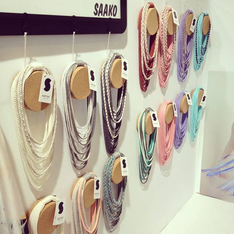 A beautiful wall of hanging colorful scarf-laces!