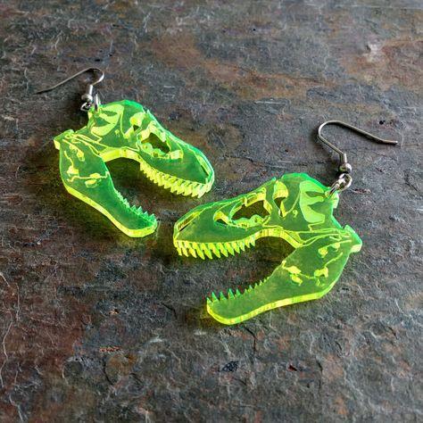 T-rex skull dinosaur earrings, laser cut acrylic (Pierced or Clip-on) Piercing t-rex piercing Weird Jewelry, Cute Jewelry, Jewelry Accessories, Jewlery, Funky Jewelry, Jewelry Trends, Funky Earrings, Skull Earrings, Dinosaur Earrings