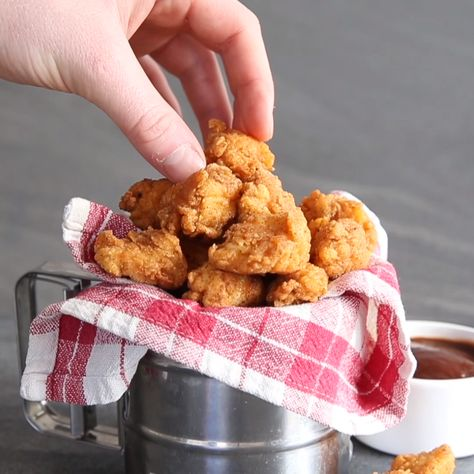 Homemade Popcorn Chicken couldn't be easier to make! The key is marinating in buttermilk for that crispy, flaky finish. But warning, these are incredibly moreish!! #popcornchicken #chicken #kfc #gameday #snack #appetizers
