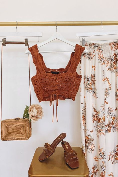Say hello to a cute new crochet crop top and floral pants. Pair with neutral accessories for endless outfits. #lovelulus