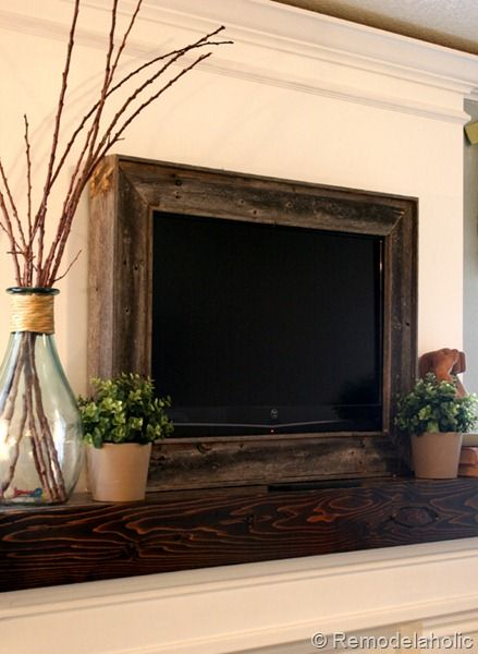 Framed TV over fireplace, great idea! Above the fireplace always seems the best spot for the TV, but it can look a little exposed and...um, tacky. Choose any frame to fit your decor. Imagine fancy carved filigree in distressed white!!!