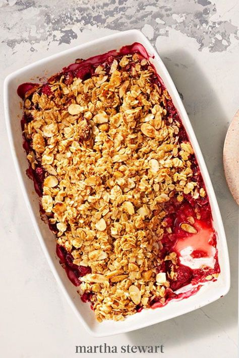 Juicy raspberries tossed in brown sugar are bursting beneath a gluten-free crumble made from butter, rolled oats, and sliced raw almonds. It's a fabulous treat for a crowd (it serves at least six!)—and no one will ever suspect that it's secretly healthy. #marthastewart #recipes #recipeideas #dessert #dessertrecipes