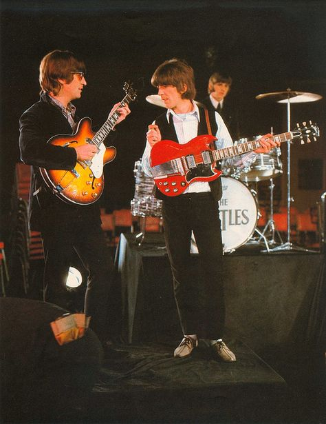 """The Beatles 'perform' their 1966 hit """"Paperback Writer"""" to be aired on the Ed Sullivan show. Guitar aficionados: George Harrison's Gibson SG, pictured here was not played on the actual recording (Fender Stratocaster was used) but he did later give it to Pete Ham of Badfinger, the first band signed to their Apple record label. You can see it in video clips of their performance of their 1971 hit 'No Matter What' produced by George."""