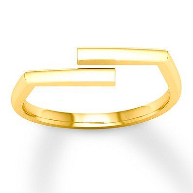 This Stylish 10 Karat Yellow Gold Fashion Ring Features Two Slanted Bars Over An Open Center Gold Rings Fashion Fashion Rings Rings