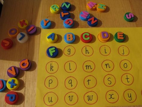 Alphabet Bottle Cap Match. Stick small foam letter stickers on to bottle caps. Ideas for activities on the site.
