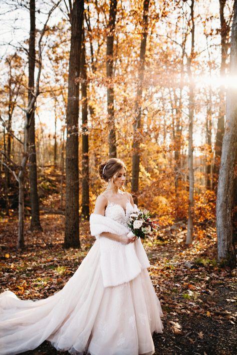 Beautiful bridal photo in the woods with fall foliage at Rock Island Lake Club | Photo: Sandford Creative