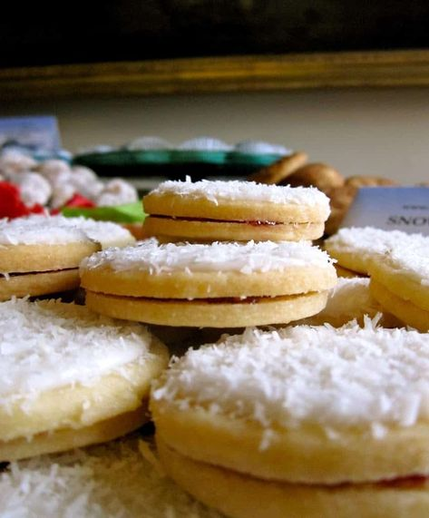 snow cookies stacked on a plate viewed from the side