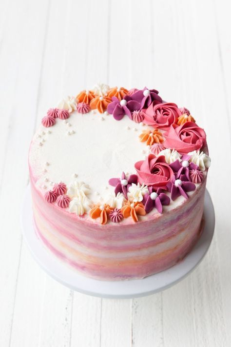 How to Make a Buttercream Flower Cake — Style Sweet - - Inspired by the colors of an autumn sunset, learn more about this watercolor buttercream technique with easy piped buttercream flowers in this How to Make a Buttercream Flower Cake tutorial. Cake Decorating Tips And Tricks, Creative Cake Decorating, Cake Decorating Techniques, Creative Cakes, Cupcake Decorating Tutorial, Cake Decorating Designs, Cookie Decorating, Creative Ideas, Flores Buttercream