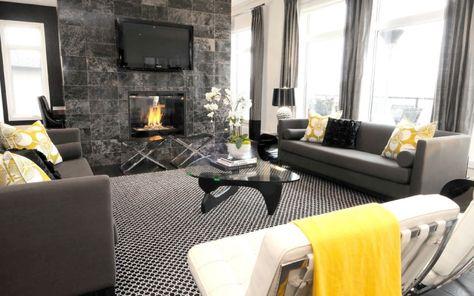 wohnzimmer kamin fliesen tv wand montiert schwarz weiß grau