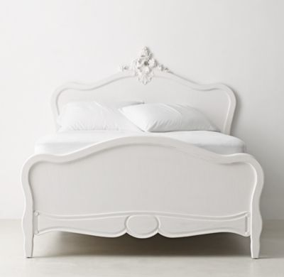 RH TEEN's Odette Bed:Inspired by a late 19th-century Rococo bed from France, our interpretation features graceful contours, exquisite carvings and a lightly distressed finish. A flourish of shells and flowers carved in high relief crowns the headboard.