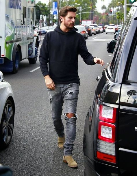 Scott Disick wearing Black Hoodie, Grey Crew-neck T-shirt, Grey Ripped Skinny Jeans, Tan Suede Chelsea Boots