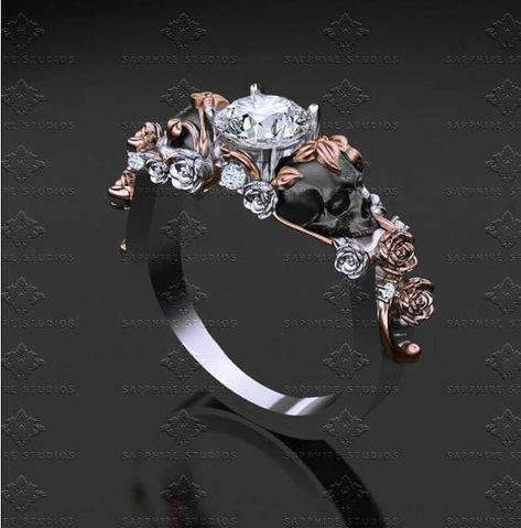 Payment plans available ID # SI-300-01   Free shipping worldwide   An exquisite round cut centre with two skulls on each side surrounded by in-twined vines and stones cascading down the band  Unique and feminine with underlying gothic yet elegant workmanship  Until death do us