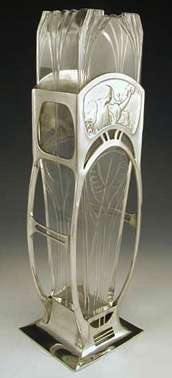 Polished pewter vase with typical Art Nouveau figural maiden decoration and original glass liner ~ Germany ~1906
