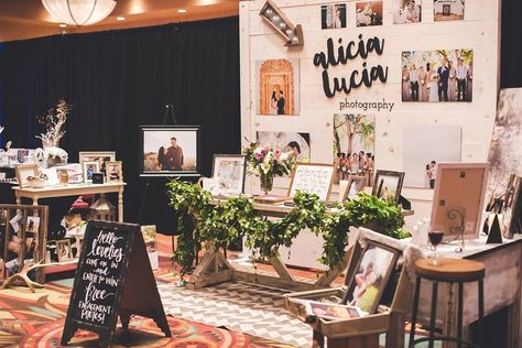 """""""A glass of wine was a must.""""  Wedding show booth inspiration // wedding show booth for photographers // bridal show booth // garland // laser cut logo // weathered wood backdrop"""