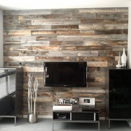 Plank wall bedroom on pinterest - Rustic wall covering ideas ...
