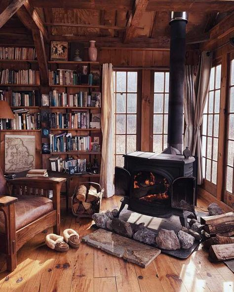 Cabin living room / library with wood-burning stove.