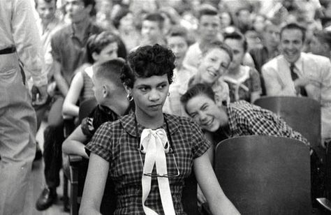 Dorothy Counts, the first African American girl to attend an all-white school school, being taunted by her peers. This girl's strength ... I can't begin to imagine.