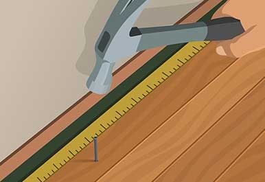 Illustration Of Someone Nailing In A Final Row Of Hardwood