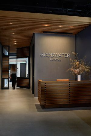 Goodwater Capital Office & Identity by Atelier Cho Thompson Goodwater Capital came to us with the mission to empower entrepreneurs who would change the world. We conceived of a brand and visual identi Corporate Office Design, Law Office Design, Office Reception Design, Modern Office Design, Office Signage, Corporate Offices, Office Designs, Modern Reception Desk, Design Offices