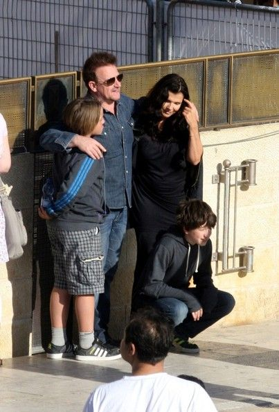 front man Bono visits the Wailing Wall with his wife, Alison, and their sons Elijah (b. August and John Abraham (b.
