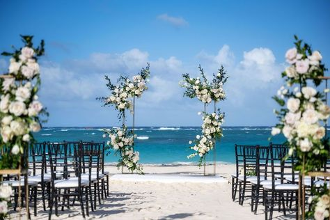 This chic beach wedding is nothing short of a dream-come-true! Beautiful brackets bare stunning white flowers, with matching arrangements, all set against the perfection of the Caribbean | Design by Kukua Wedding Team | Photo by PhotoCineArt | #weddingwire #kukuapuntacana #kukuaweddings #weddingceremony #ceremonydecor #weddingblog #weddingsetup #weddingphoto #weddingdream #weddingforward #weddingdayphoto #weddinggoals #weddingtime #weddingdesign #chicwedding #modernwedding #weddingdesign