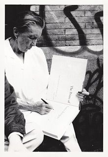 Louise Bourgeois autographing the catalogue, 1994. Photo: Peter Bellamy
