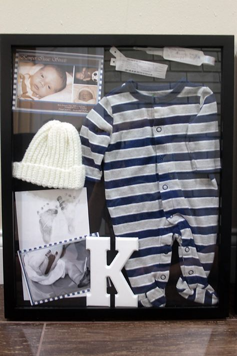 Things to possibly include: Hospital band, first shoes, newspaper from the day he is born, going home outfit, hat, first tooth, sonogram pic...
